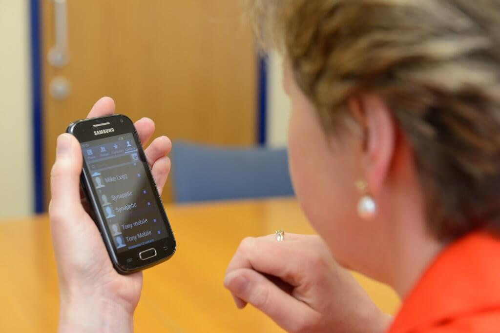 This is a picture of a trustee using a mobile phone.
