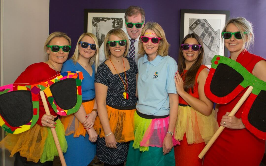 This picture shows Thursfields staff wearing colourful tutus, garlands and sunglasses
