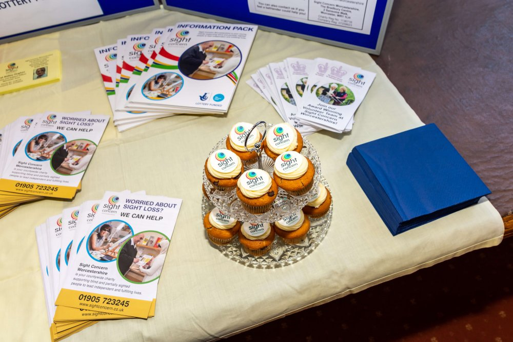 This image shows Sight Concern Cupcakes and leaflets.