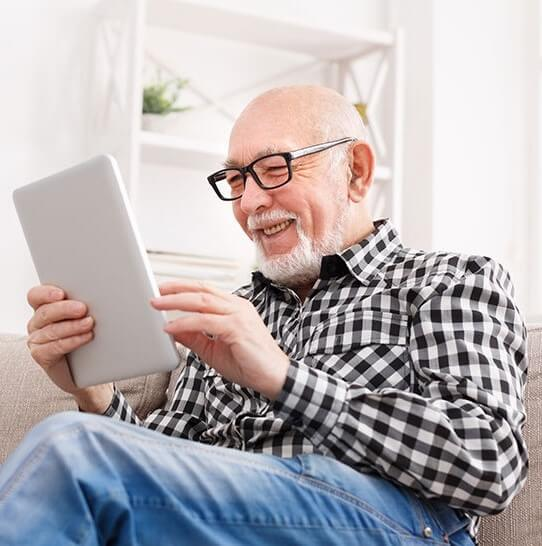 this is an image of a man reading a tablet