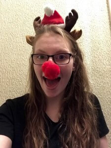this is a photo of world champion paralympian swimmer becky redfern wearing a red nose and antlers