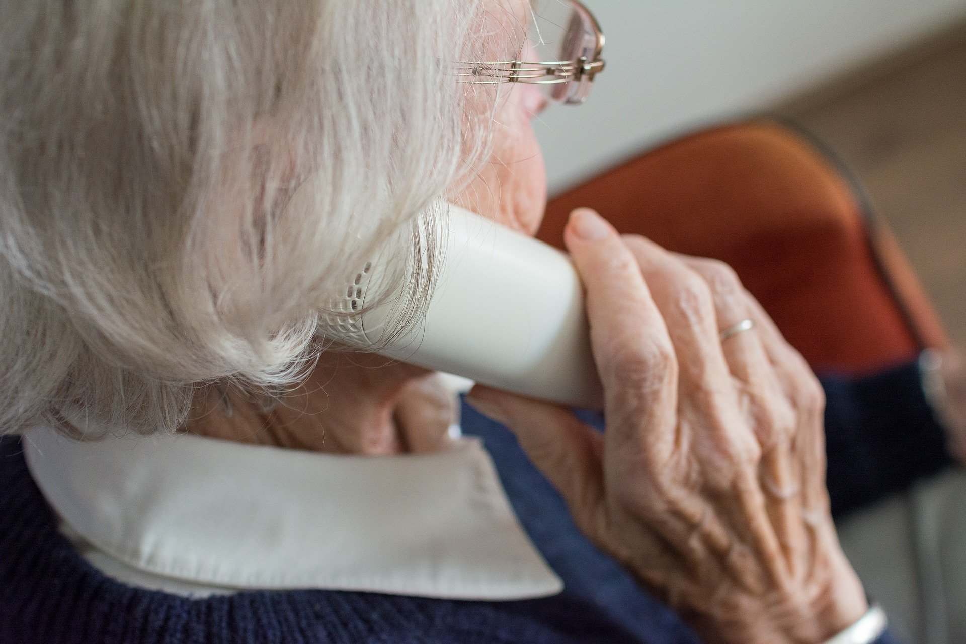 this is an image of an older woman holding a phone